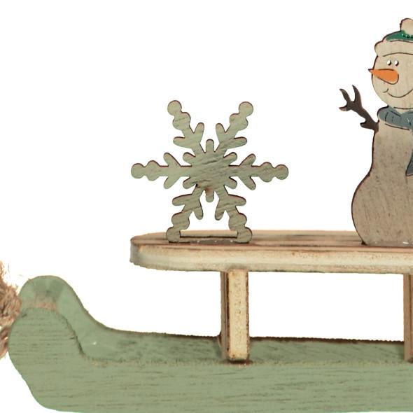 Deko-Schneemann auf Schlitten
