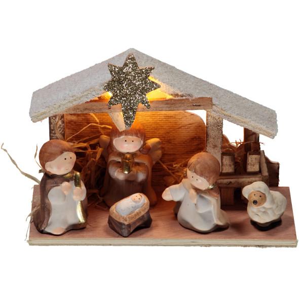 Krippe mit kleinen Porzellanfiguren